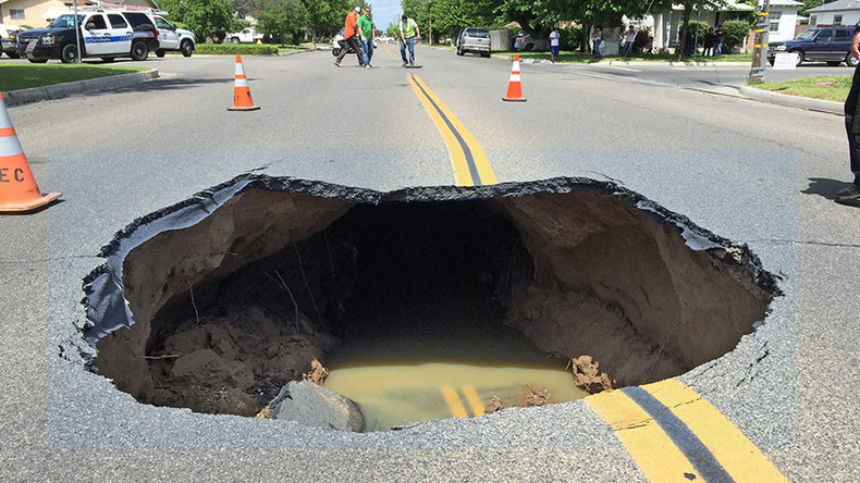 Traffic-stopping sinkhole devours California street (VIDEO)