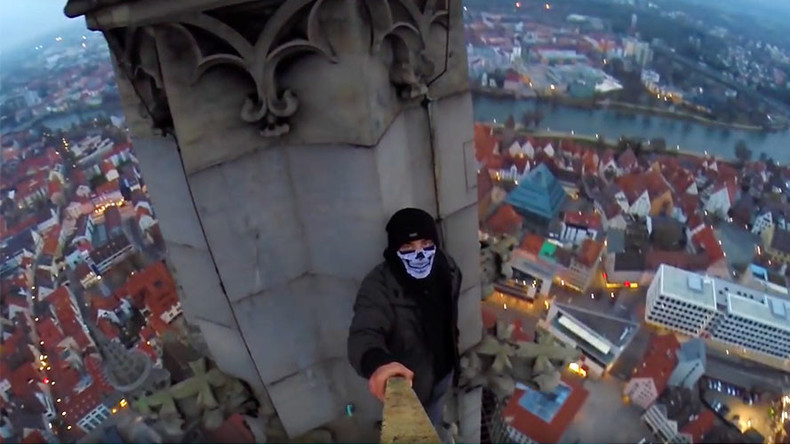 Fearless climber scales world's tallest church in nail-biting footage (VIDEO)