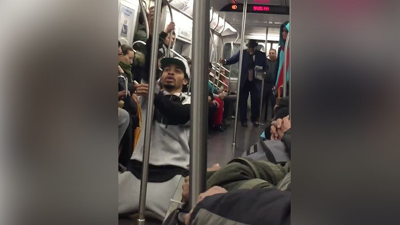 Businessman challenges street performer in NYC subway dance-off (VIDEO)