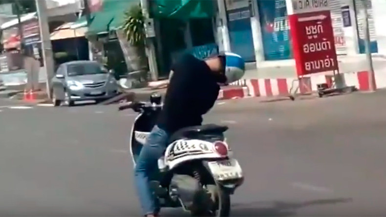 Zombie biker! Sleeping man rides moped through streets of Thailand (VIDEO)