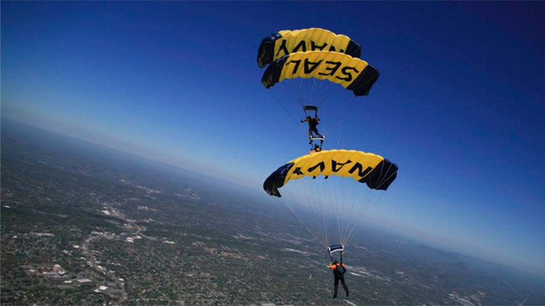 Navy Seals pull off heart-stopping parachute jump into packed stadium (VIDEO)