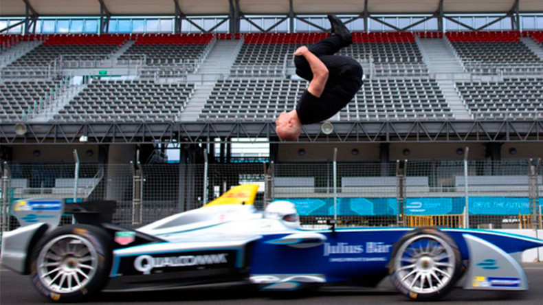 Leap of faith: Stuntman clears speeding race car in 'blind backflip' (VIDEO)