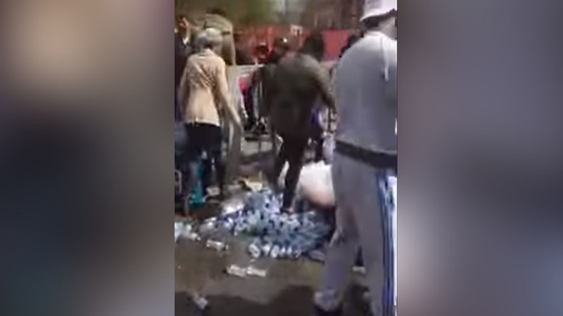 Uproar as London marathon water bottles snatched by roadside (VIDEO)