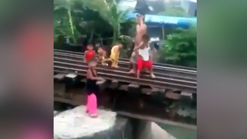Kids at play dodge oncoming train by hiding beneath tracks (VIDEO)
