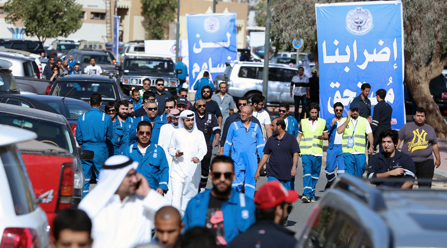 Thousands of Kuwait oil workers go on strike against pay cuts