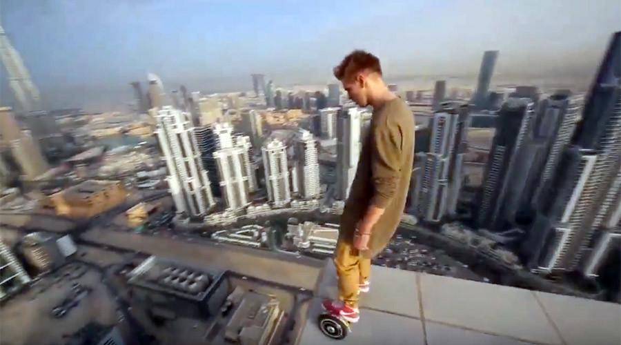 Daredevil Russian hoverboards on the edge of Dubai skyscraper in vertigo-inducing stunt (VIDEO)