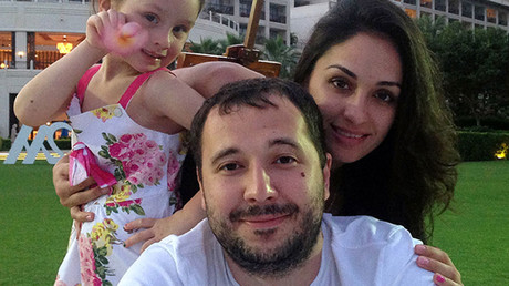 Undated family photo taken in Sochi shows Roman Seleznev (C), the son of a Russian lawmaker from the Liberal-Democratic Party (LDPR), posing with his partner Anna Otisko (R) and their daughter. © AFP