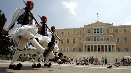 Greek soldiers in traditional uniform perform the ceremonial changing of the guard in front of the Greek Parliament and the Tomb of the Unknown Soldier in Athens © Mike Blake
