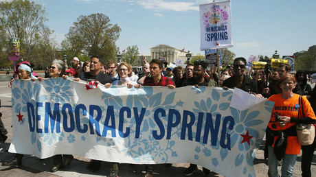 Democracy Spring protesters march to the U.S. Capitol to protest big money in politics, April 11, 2016 in Washington, DC. © Mark Wilson