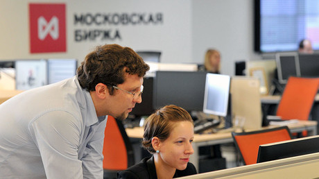 Employees seen at the office of the MICEX-RTS Stock Exchange. ©Sergey Kuznecov