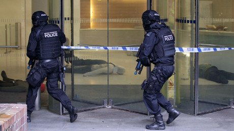 Armed Response Vehicle (ARV) officers participate in a police exercise simulating a millitant attack on a shopping centre during a Metropolitan Police training program for armed officers in London. © Yui Mok