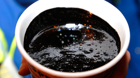 A cup of heavy oil produced at the Statoil oil sands operation near Conklin, Alberta © Todd Korol