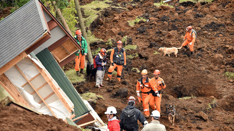 Rescuers guide dogs to search for victims buried in a landslide due to the recent earthquakes in the village of Minami-Aso in Kumamoto prefecture on April 18, 2016. © Kazuhiro Nogi
