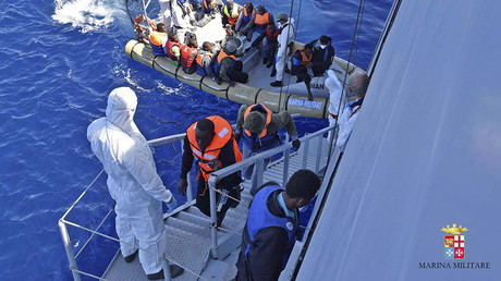 Migrants sit in a rescue boat during a rescue operation by Italian Navy vessels off the coast of Sicily in this April 11, 2016 handout picture provided by Marina Militare. ©Marina Militare