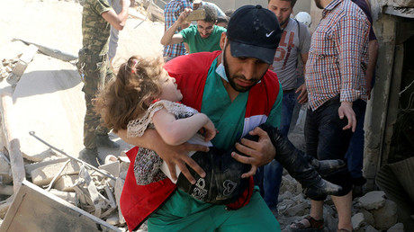 A civil defense member carries a child that survived from under the rubble at a site hit by airstrikes in the rebel held area of Old Aleppo, Syria, April 28, 2016. © Abdalrhman Ismail