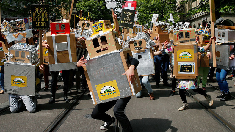 'Robot' activists in Switzerland demand guaranteed income for all humans (VIDEO)