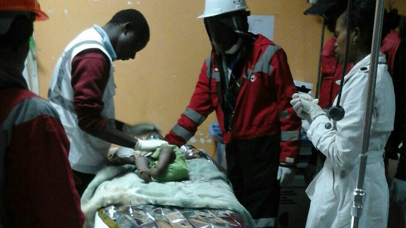 Miracle in Nairobi: Baby rescued from rubble 80 hrs after building collapses (PHOTOS)