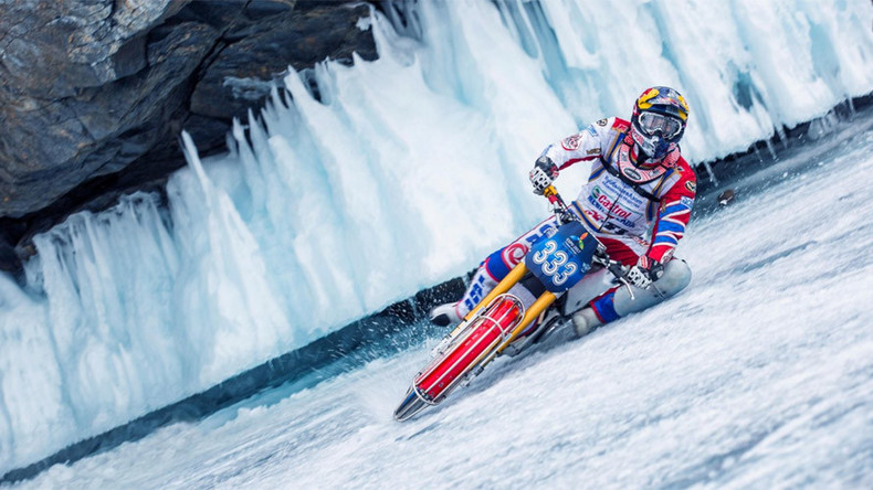 World ice-motorbiking champ dares ride on thawing Lake Baikal… with shaman's help (VIDEO)