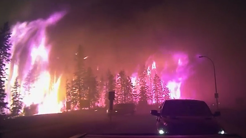 Scary VIDEO: Dashcam shows people & beasts escaping Apocalyptic Fort McMurray inferno