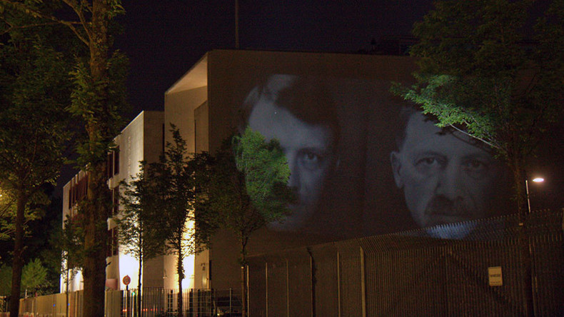 'Anti-ISIS campaign': Light artists of 'Daesh bank' protest to fight terror backers & propaganda
