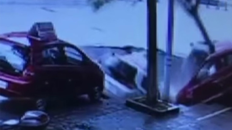 Watch how giant sinkhole swallows four cars in China (VIDEO)