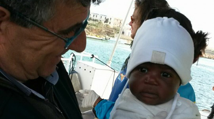 Terrifying migrant boat disaster captured as orphaned baby steals Italy's heart (PHOTOS, VIDEO)