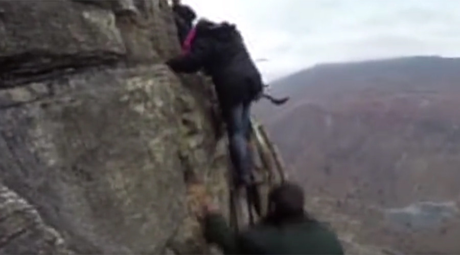 Really high school: Children tackle 800-meter high cliff en route to class (VIDEO)