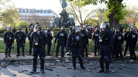 French CRS riot police secure a position at the Place de la Nation after clashes with youths who protest against the French labour law proposal during the May Day labour union march in Paris, France, May 1, 2016. © Charles Platiau