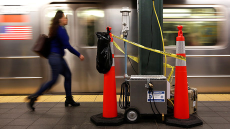 A woman walks by a device used for chemical tracers used by the Department of Homeland Security and New York Metropolitan Transportation Authority during a test of how gas would flow through the subway system in New York, U.S., May 9, 2016 © Shannon Stapleton