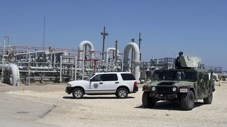 Private security contractors patrol the U.S. Department of Energy's Stategic Petroleum Reserve in Bryan Mound, Texas. © Donna W. Carson