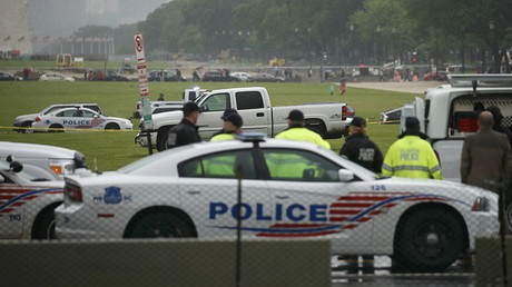 U.S. Capitol Police suuround a white pickup truck after a man drove it onto the National Mall in Washington, U.S., May 17, 2016. © Kevin Lamarque