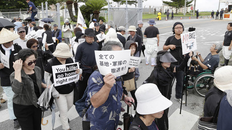 Okinawa residents stage a protest against a murder of the 20-year-old Rina Shimabukuro, in front of the gate of Camp Foster in Kitanakagusu, Okinawa prefecture on May 22, 2016. © Jiji Press