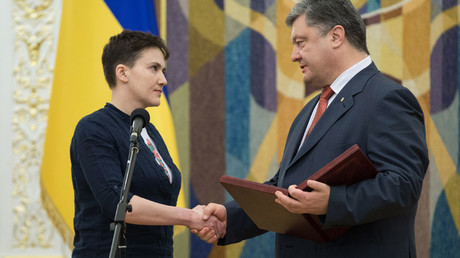 Poroshenko vows 'to bring back' E.Ukraine, Crimea after Putin pardons Ukrainian pilot Savchenko