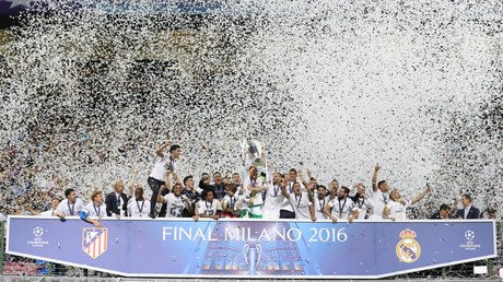 Real Madrid's Sergio Ramos lifts the trophy as they celebrate winning the UEFA Champions League © Carl Recine