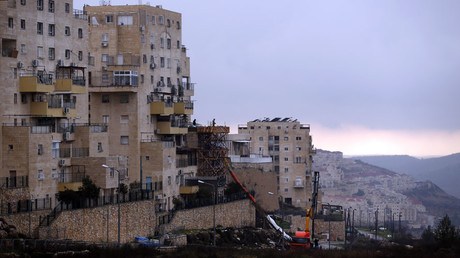 A building under construction is seen in the West Bank Jewish settlement of Beitar Illit © Amir Cohen
