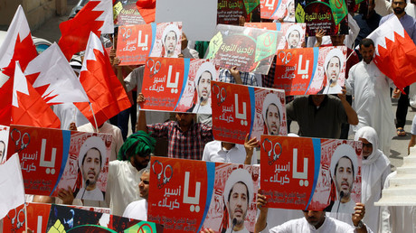 Protesters hold banners with photos of opposition leader and head of Al Wefaq party Ali Salman during a protest after Friday prayers in the village of Diraz, Bahrain, May 13, 2016. © Hamad I Mohammed