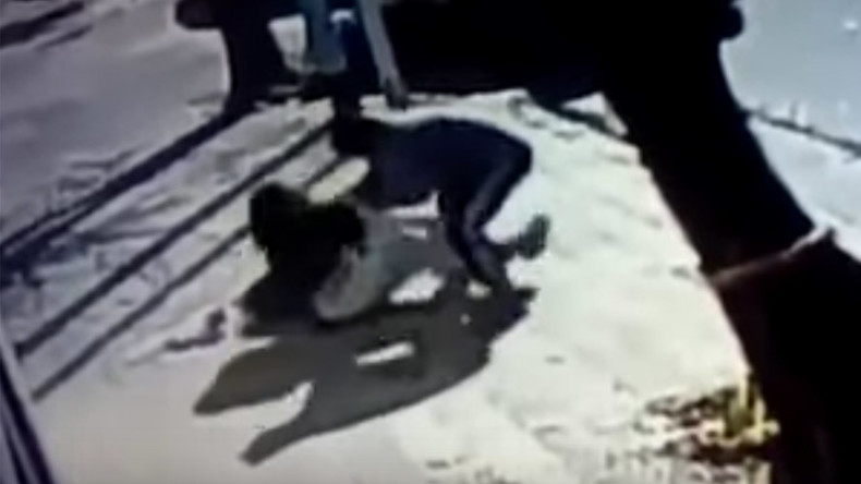 CCTV films man tackling woman to the ground in bid to take her baby (VIDEO)