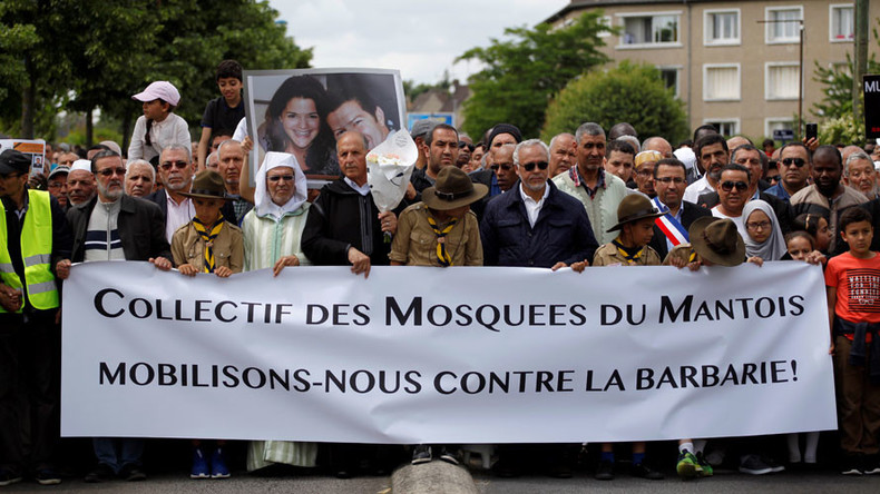 'I am the police': French Muslims rally to honor police officers killed by extremist