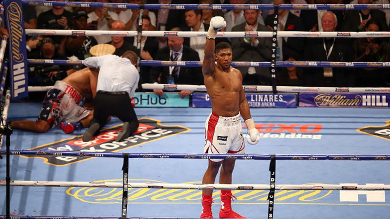 Anthony Joshua knocks out Dominic Breazeale in round 7 to retain world title
