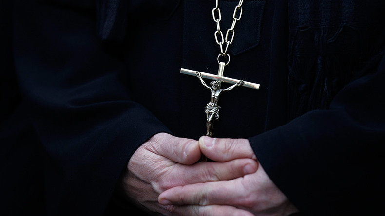 Coptic Christian priest killed in 'hail of bullets' outside Egyptian church