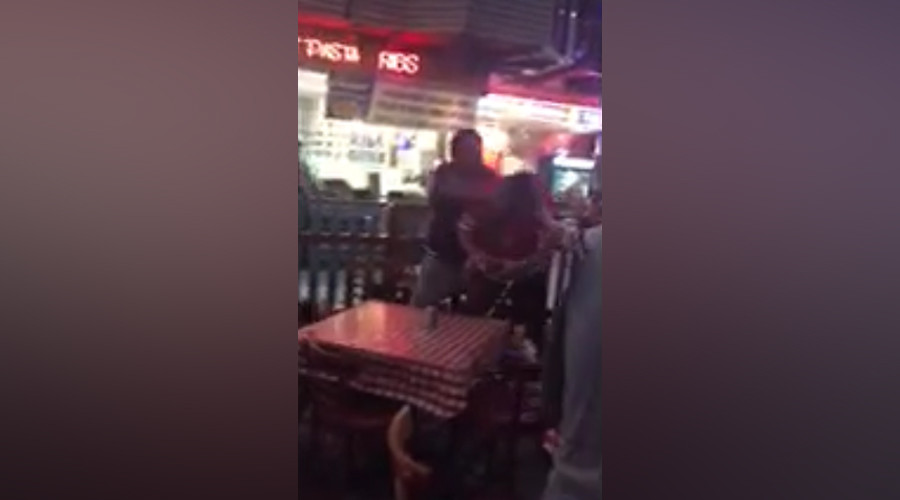 Newly released video shows off-duty cop punching restaurant patron in face