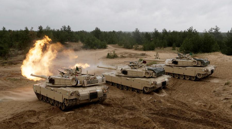 Putin: Russia will respond to 'aggressive NATO rhetoric'