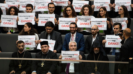 Armenian clergy men and activists react after law makers voted to recognise the Armenian genocide after a debate during the 173rd sitting of the Bundestag, the German lower house of parliament, in Berlin on June 2, 2016 © Odd Andersen