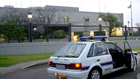 A South African police car is parked 11 September 2001 in front of the United States embassy in Pretoria © Nerrisa Korb