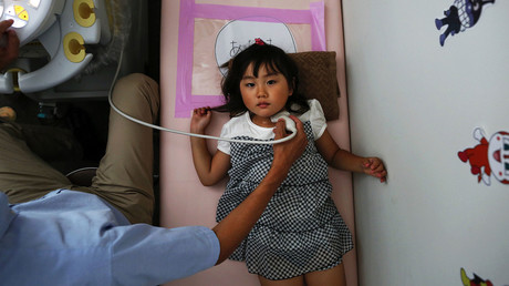 A doctor conducts a thyroid examination on four-year-old Maria Sakamoto, brought by her mother to the office of Iwaki Radiation Citizen Centre NPO, Iwaki town, Fukushima prefecture. © Damir Sagolj