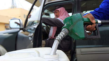 An employee fills a container with diesel at a gas station in Riyadh ©Fahad Shadeed