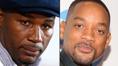 Former British heavyweight boxer Lennox Lewis (L) and actor Will Smith. © Reuters / AFP