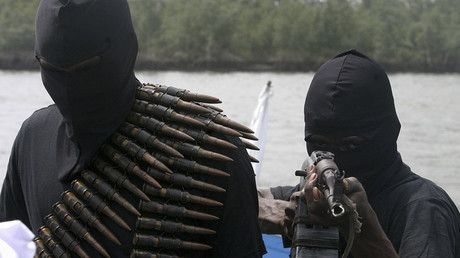 Militants patrols the creeks of the volatile Niger Delta in Nigeria. © George Esiri