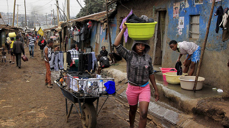 Young girls do laundry outside their house early morning in Nairobi's Kibera slums. © Noor Khamis
