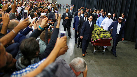 Worshipers and well-wishers take photographs as the casket with the body of the late boxing champion Muhammad Ali is brought for his jenazah, an Islamic funeral prayer, in Louisville, Kentucky, U.S. June 9, 2016 © Carlos Barria